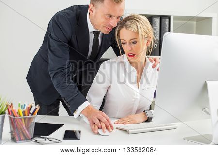 Boss touching his secretary at the office
