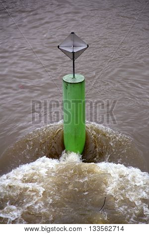 green tag on a fast flowing river
