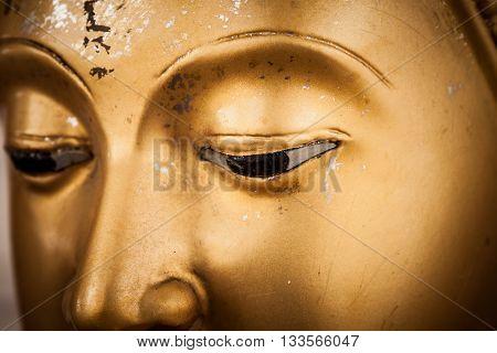 closeup eyes golden buddha in temble at Thailand