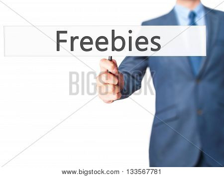 Freebies - Businessman Hand Holding Sign