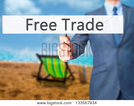 Free Trade - Businessman Hand Holding Sign