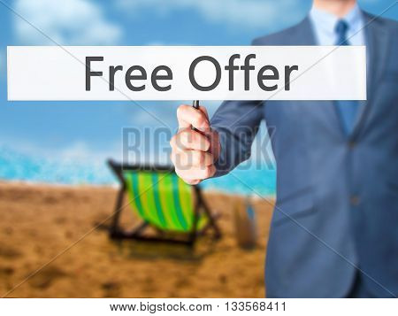 Free Offer - Businessman Hand Holding Sign