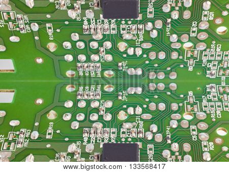 Electronic integrated circuitry macro mirror detail. Technology background. Horizontal