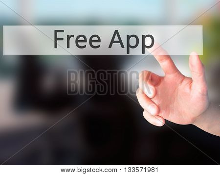 Free App - Hand Pressing A Button On Blurred Background Concept On Visual Screen.