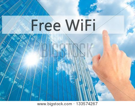 Free Wifi  - Hand Pressing A Button On Blurred Background Concept On Visual Screen.