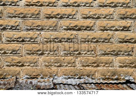 Vintage brick stone wall background on historical cotton gin building.