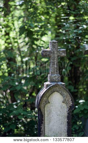 stone cross in a cemetery