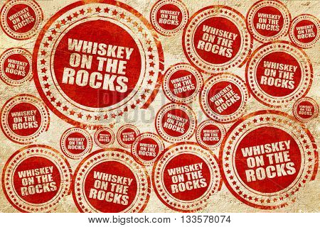 whiskey on the rocks, red stamp on a grunge paper texture