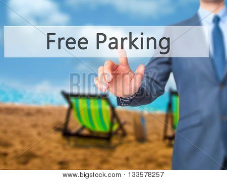 Free Parking - Businessman Hand Pressing Button On Touch Screen Interface.