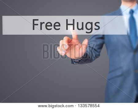 Free Hugs - Businessman Hand Pressing Button On Touch Screen Interface.