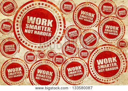 work smarter not harder, red stamp on a grunge paper texture