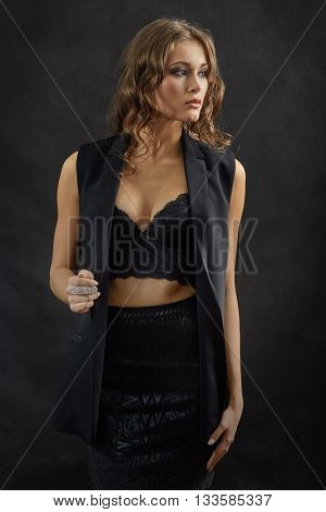 sensual woman with big breast on black background