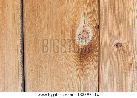 Outdoor wood grain and paneling extreme close up with wood knot