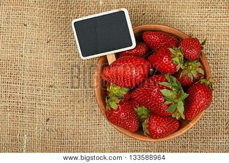 Strawberry In Bowl And Price Sign On Canvas