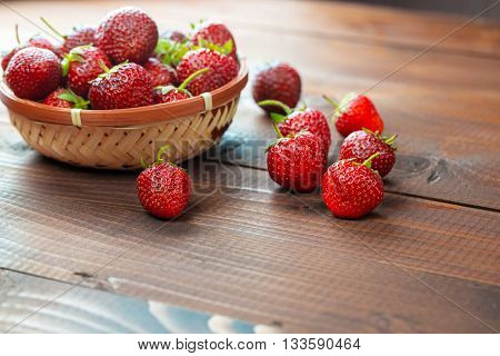 Very Beautiful Background With Fresh Strawberries In A Wicker Round Osier Basket On Old Brown Wooden