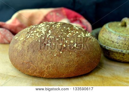 Loaf of Brown Bread: Round loaf of whole wheat bread made using molasses and rolled oats