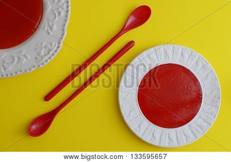 strawberry marmalade with basil and mint on yellow background poster