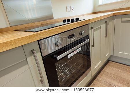 Oven and hob built into kitchen cupboards