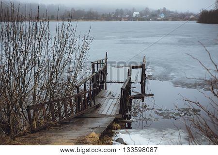 Cold Melancholic Spring Landscape with Lake .