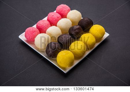 Gulab Jamun or kala jamun and Chum Chums or multicolour rassgulla or rasagulla, famous bengali sweets, selective focus