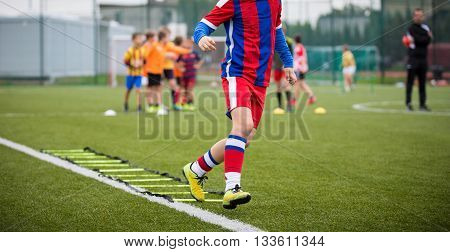 Ladder Drills Exercises for Football Soccer team. Young player exercises on ladder drills