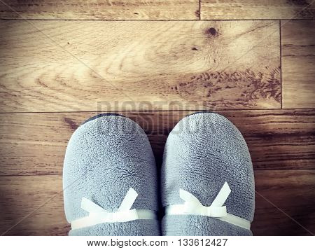 slippers on wooden floor top view with copy space