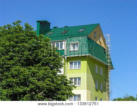 Minsk, Belarus - June 9, 2016 : Experimental architectural project - the superstructure of the attic in an old five-storey building, Serdich street