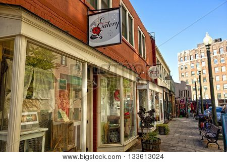 ASHEVILLE, NORTH CAROLINA - APRIL 18, 2016:  Wall Street in Asheville, North carolina offers an eclectic assortments of restaurants and boutiques.  this is a popular tourist destination