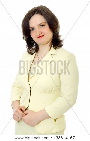 half-lenght young woman with dark hair in a light yellow jacket stands white background, isolated