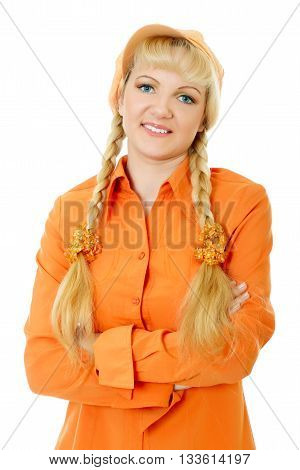 blond hair and blue eyes girl in orange blouse and cap folds arms. Half-lenght portrait, white background, isolated