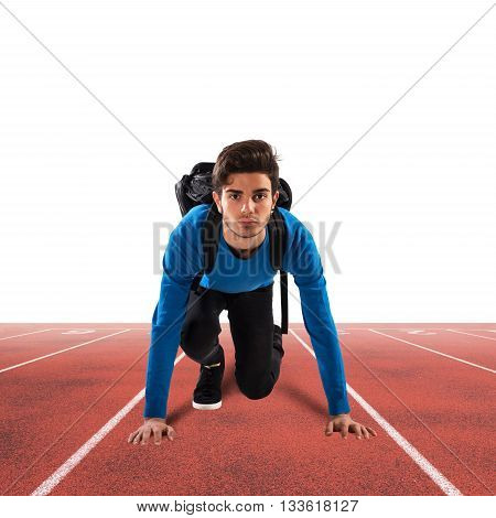 Teenager boy with backpack ready to run