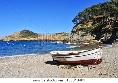 closeup of an old fishing boat stranded on the Sa Tuna beach in Begur, in the Costa Brava, Catalonia, Spain