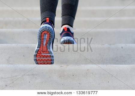 Girl Jogging Up Steps.