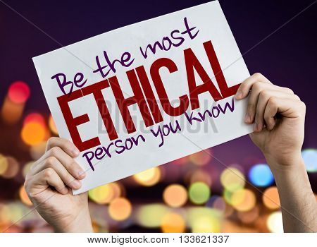 Be The Most Ethical Person You Know placard with night lights on background