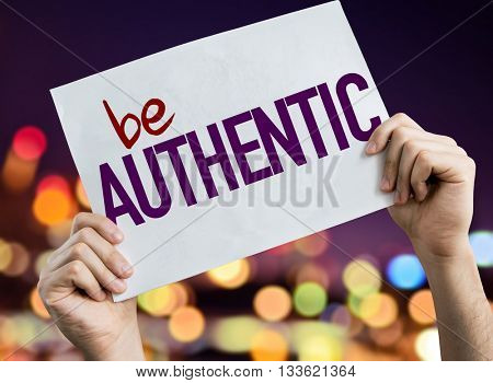 Be Authentic placard with night lights on background