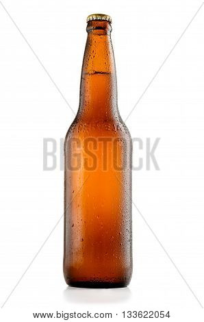 Bottle of beer with drops isolated on white background and with clipping path