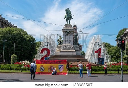 Milan Italy - May 25 2016: Bronze monument to Giuseppe Garibaldi in Piazzale Carioli -Piazza Castello- in Milan was modelled in 1895 by Ettore Ximenes. Soccer fans came to the Champions League final.