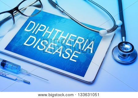 Diphtheria Disease word on tablet screen with medical equipment on background