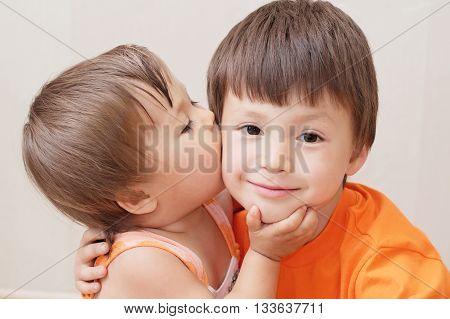 Little Sister Kissing Older Brother