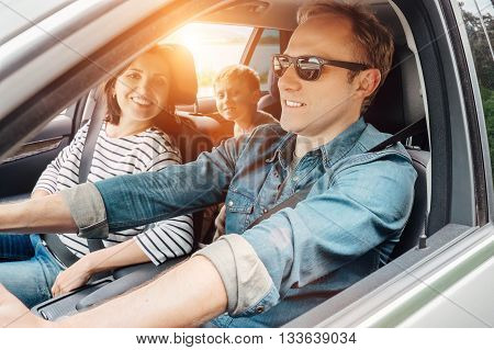 Young Family into the car during travel