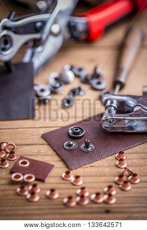Leather hole punch with brass rings, studio shot