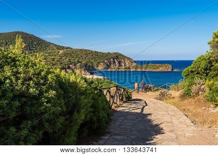 SARDEGNA ITALY. circa JULY 2015. Trail at coast hills near one of the most beautiful Kia beaches. Tourists looking to bay