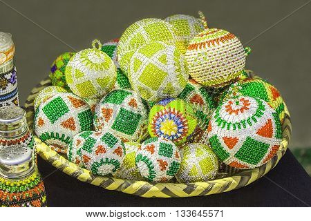 Traditional ethnic African  colorful bead toys balls. Christmas decorations. Unique craftsmanship. Local craft market in South Africa.