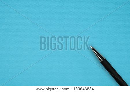Blue papper background with black ball pen and text space