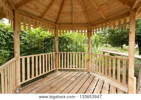 Inside of wooden gazebo in garden under construction