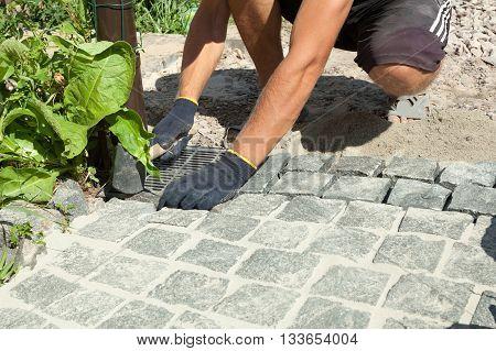 Wizard puts the blocks making the sidewalk