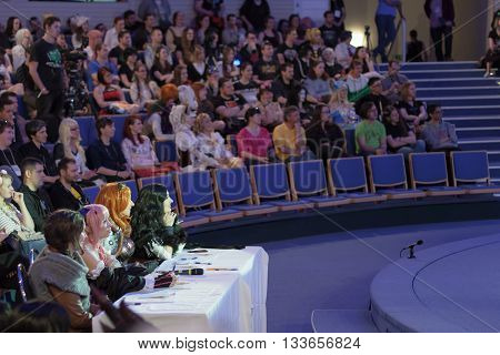 Four Jurors Sitting At The Table During Cosplay Contest