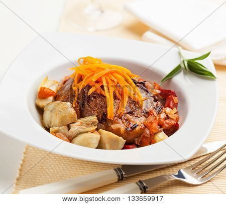 Pork with artichokes and stir fried vegetables