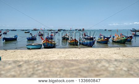 Vung Tau, Vietnam, 21st March 2016. Fishing boats laying in the sea close to the seashore at the main beach of Vung Tau.