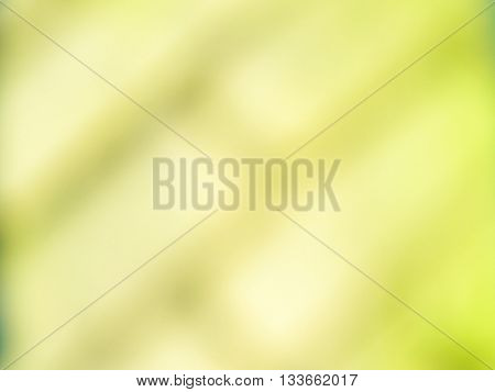 Abstract bright blurry un-focused background pattern texture with bricks running diagonally in green white turquoise.